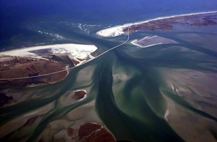 Experts seek new ideas to keep oregon inlet clear for Oregon inlet fishing center camera