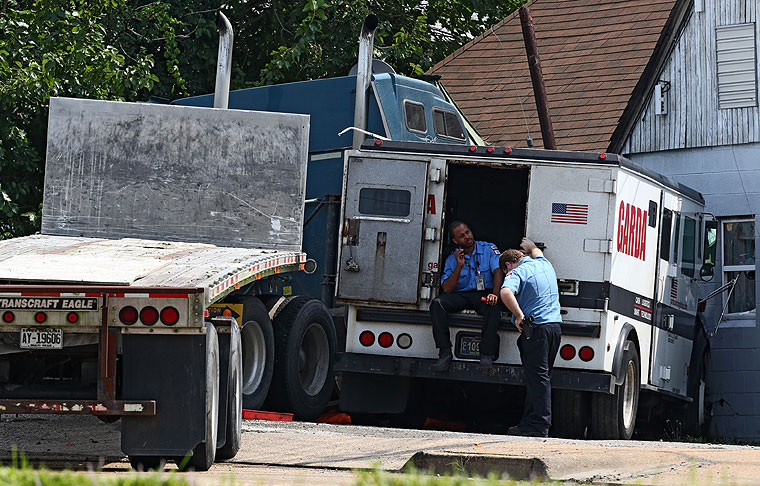Private Officer Breaking News: Armored truck-semi collide in ...