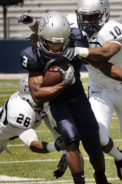 ODU's wide receiver, Marquel Thomas, manages to break a couple of tackles to pick up some ground during the Monarchs spring football scrimmage. Norfolk April 10, 2010. (David B. Hollingsworth | The Virginian-Pilot)