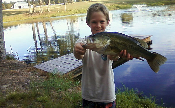 Youngster hooks big bass during family contest for Hampton roads fishing report