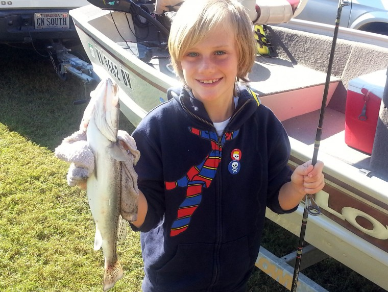 Angler Reels In Hook Line Sinker And Trout