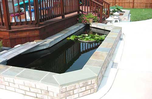 Raised pond has formal elegance for Diy raised pond ideas